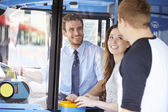 Young Couple Boarding Bus And Buying Ticket — Foto de Stock