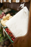 Paper Bags By Fruit Counter Of Farm Shop — Stock Photo