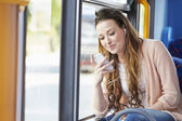 Young Woman Wearing Earphones Listening To Music On Bus — Stock Photo
