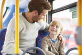 Father And Son Enjoying Bus Journey Together — Stockfoto