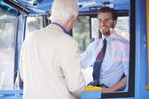 Senior Man Boarding Bus And Buying Ticket — Stock Photo
