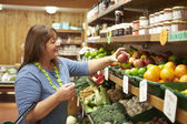 Female Customer At Vegetable Counter Of Farm Shop — Stock Photo