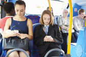 Passengers Sitting On Bus Sending Text Messages — Stock Photo