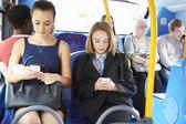 Passengers Sitting On Bus Sending Text Messages — Foto de Stock
