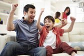 Father And Son Watching Sports On TV — Stock Photo