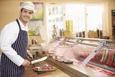 Butcher Preparing Meat In Shop — Stock Photo
