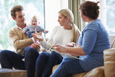 Social Worker Visiting Family With Young Baby — Stock Photo