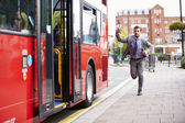 Businessman Running To Catch Bus Stop — Stockfoto