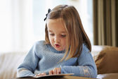 Young Girl Reading Story At Home — Stock Photo