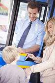 Mother And Son Boarding Bus And Using Pass — Stock Photo