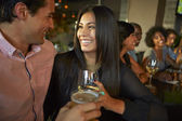 Couple Enjoying Drink At Bar With Friends — Photo