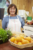 Female Sales Assistant At Checkout Of Farm Shop — Stock Photo