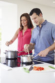 Hispanic Couple Cooking Meal At Home Together — Stock Photo