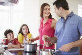 Hispanic Family Cooking Meal At Home Together — Stock Photo