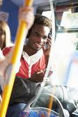 Man Wearing Headphones Listening To Music On Bus Journey — Stock Photo