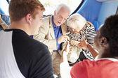 Senior Couple Being Harassed On Bus Journey — Stock Photo