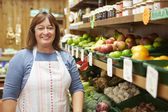 Female Sales Assistant At Vegetable Counter Of Farm Shop — Stock Photo
