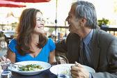 Mature Couple Enjoying Meal At Outdoor Restaurant — Stock fotografie