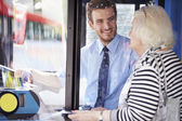 Senior Woman Boarding Bus And Buying Ticket — Stock Photo