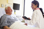 Doctor With Digital Tablet Talking To Patient In Hospital — Stock Photo