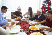 Multi Generation Family Enjoying Christmas Meal At Home — Foto Stock