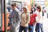 Queue Of People Waiting At Bus Stop — Stock Photo