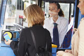 Woman Boarding Bus And Using Pass — Stock Photo