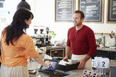 Customer Paying In Coffee Shop Using Touchscreen — Stock Photo
