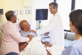 Medical Team Meeting With Senior Couple In Hospital Room — Stock Photo