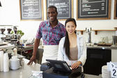 Male And Female Staff In Coffee Shop — Foto de Stock