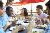 Group Of Friends Enjoying Meal At Outdoor Restaurant — Stockfoto