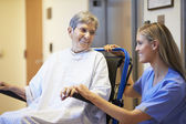 Senior Female Patient Being Pushed In Wheelchair By Nurse — Stock Photo