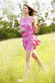 Attractive Woman Running Through field — Stock Photo