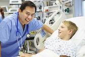 Boy Talking To Male Nurse In Emergency Room — Stock Photo