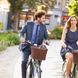 Couple Riding Bike in City Park — Stock Photo #50695595