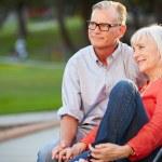 Mature Couple Sitting On Bench — Stock Photo #50695633