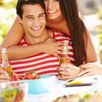 Couple Enjoying Outdoor Meal In Garden — Stock Photo #50695673