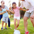 Family Playing Soccer In Park — Stock Photo #50695863