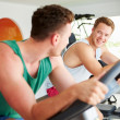 Men Training In Gym On Cycling Machines — Stock Photo #50695989