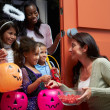 Children Going Trick Or Treating — Stock Photo #50696059
