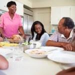 Multi-Generation Family Eating Meal — Stok fotoğraf #50696201