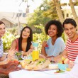 Friends Enjoying Meal At Outdoor Party — Stock Photo #50696307