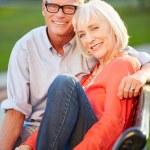 Mature Couple Sitting On Bench — Stock Photo #50696545