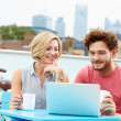 Couple Using Laptop — Stock Photo #50696819