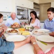 Family Saying Prayer Before Eating Meal — Stock Photo #50697025