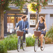 Couple Riding Bike in City Park — Stock Photo #50697139