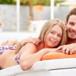 Couple  Relaxing By Swimming Pool — Stock Photo #50697159