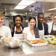 Kitchen Staff In Homeless Shelter — Stock Photo #50697217