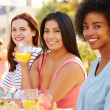 Three Female Friends Enjoying Meal — Stock Photo #50697363