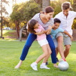 Family Playing Soccer In Park — Stock Photo #50697379